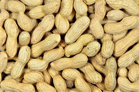 goober peas: close up of peanuts monkey nuts with shells, detail, macro, full frame, horizontal