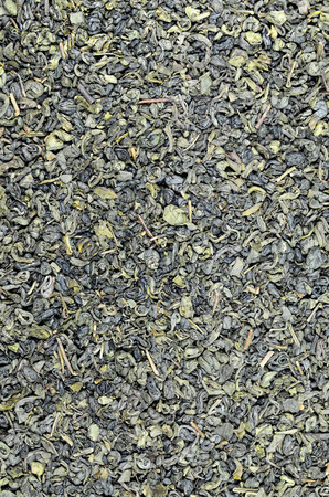 leaflets: close up of green tea Gunpowder leaflets, detail, macro, full frame, vertical