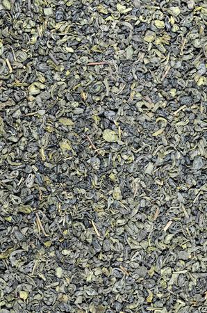 gunpowder: close up of green tea Gunpowder leaflets, detail, macro, full frame, vertical