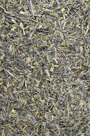 sencha tea: close up of green tea Sencha leaflets, detail, macro, full frame, vertical