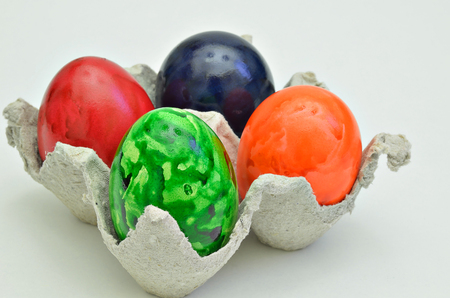marmorate: colorful Easter eggs in a cardboard box, close up, isolated on white background, horizontal Stock Photo