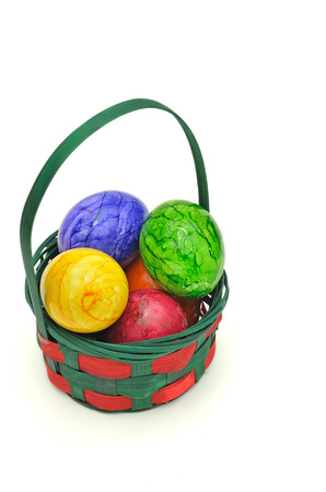 marmorate: colorful Easter eggs in a basket, close up, isolated on white background, horizontal Stock Photo