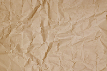 creasy: Close up of a creased, ocher paper texture, full frame, horizontal