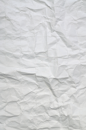 creasy: Close up of a creased, white paper texture, full frame, vertical Stock Photo