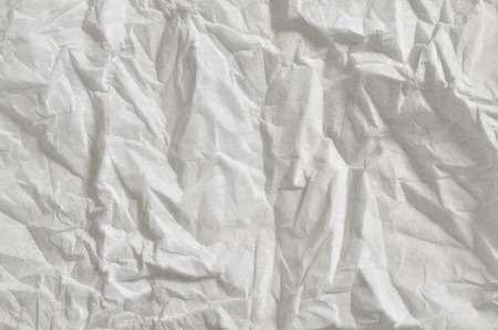 hanky: Close up of a creased, white, soft paper texture, full frame, directly above, horizontal