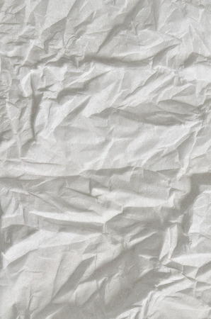 hanky: Close up of a creased, white, soft paper texture, full frame, close above, vertical Stock Photo