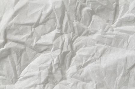 pillowy: Close up of a creased, white, soft paper texture, full frame, directly above, horizontal