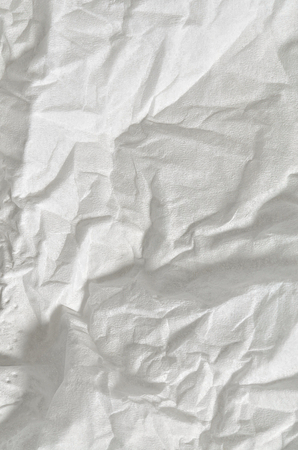 pillowy: Close up of a creased, white, soft paper texture, full frame, close above, vertical Stock Photo
