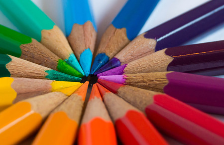 Many different colored pencils put in a circle on a white background. Colored pencils rainbow. Stock Photo