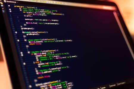 Software development. Software source code. Programming code. Writing code programming on laptop.