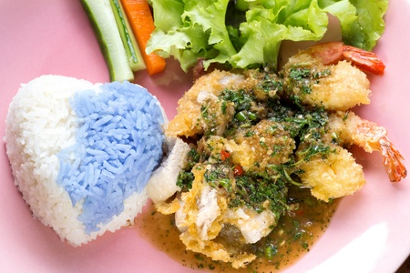 white and purple Rice with basil sauce chicken pork shrimps Thai food photo