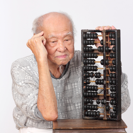 elderly: old man use chinese abacus thinking