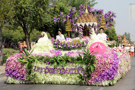 Anniversary Chiang Mai Flower Festival 2015, Unidentified women is in parade with fresh flowers decorate car in Chiang Mai flower festival on February 7, 2015 in Chiang Mai,Thailand.