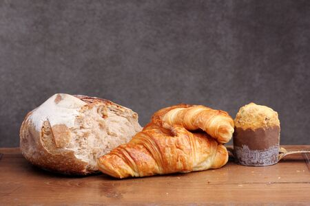 teakwood: sour dough bread croissant muffin on teakwood table Stock Photo