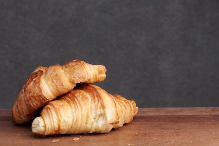 teakwood: croissant bakery on teakwood table Stock Photo