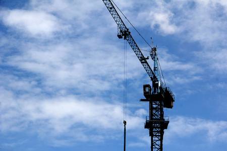 build in: crane working to lift equipment for build in blue sky Stock Photo