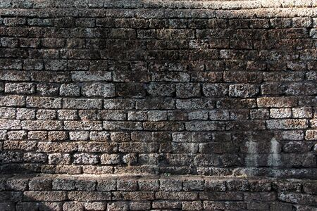 porous brick: texture of old brown laterite stone vintage wall  grunge surface shadow