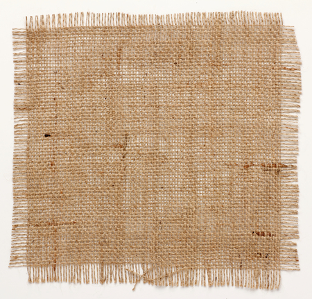 texture of Burlap hessian square with frayed edges on white background