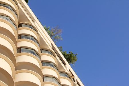 buliding: looking up to high buliding and blue sky. Lots of copy space Stock Photo