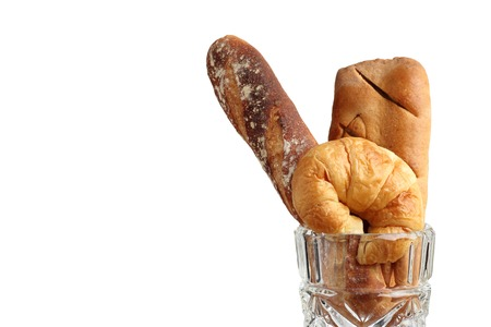 croissant brad bakery in glass blow on teakwood table lighting and white background isolated Stock Photo