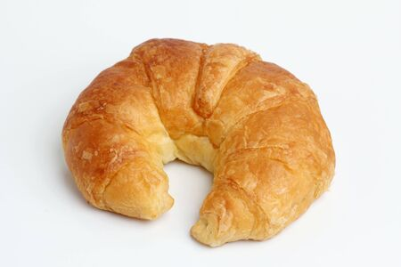 glod: one brown glod croissant  on white background