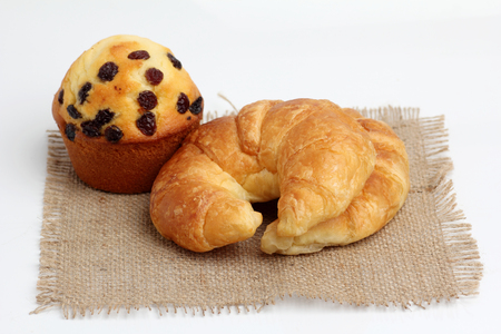 frayed: croissant muffin on spuare frayed burlap white background