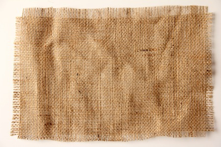 Burlap hessian with frayed edges on white background