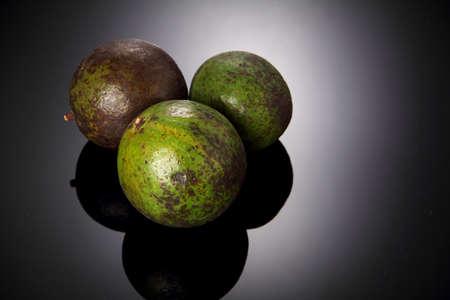 high light: fresh avocado fruit in studio shot high light background Stock Photo