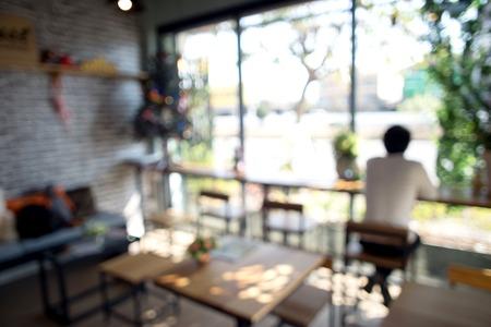 alone: blur coffee shop window light a man sit alone Stock Photo