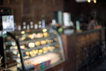 mocked: blur coffee shop cake refrigerator wood counter view