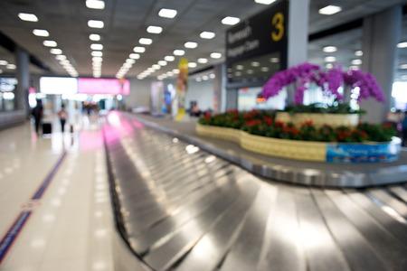 Blur luggage claim belt in airport teminal
