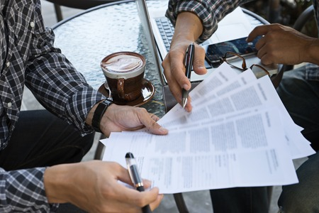 bussiness man: bussiness man hand paper work sign contract