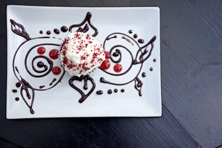 red velvet cupcake: red velvet cupcake decorate with chocolate on white plate