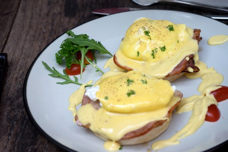 benedict: Egg Benedict all day breakfast on wood table Stock Photo
