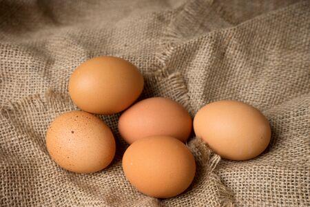frayed: egg on burlap material background hessian with frayed edges
