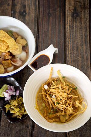 soi: yellow spicy noodle thai food khao soi  on dark wood table