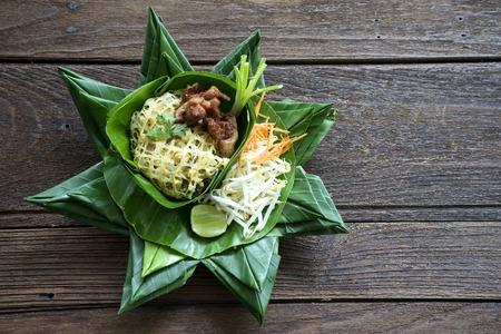 leaf vegetable: Pad Thai Thailand food on banana leaf  wood table
