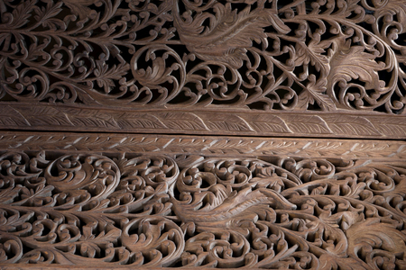 teak wood carving background texture in Thai style