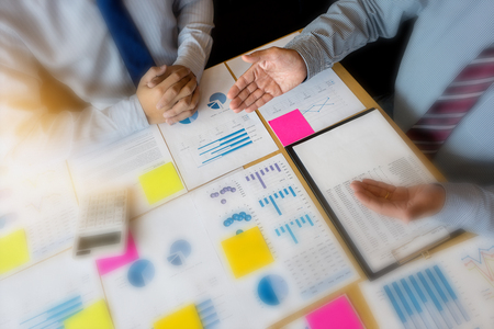 Two businessman working  with graph chart for marketing plan