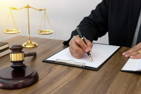 lawer or  judge work in the office with gavel and balance