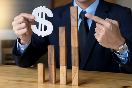 business concept plan and risk money project business image by Wood block tower and dollar sign Stock Photo