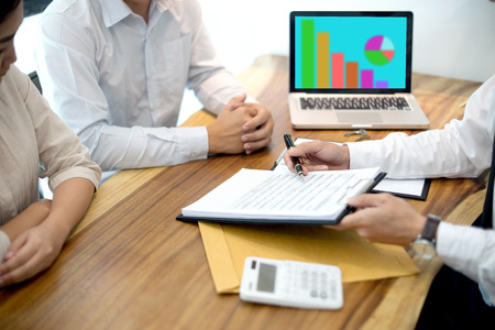 Business man agreement to sign for contract for new home buy or rent with white computer screen clipping path.