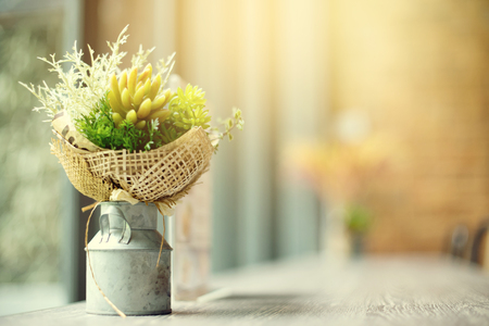 Blur flower in Steel vase wall background vintage tone 스톡 콘텐츠