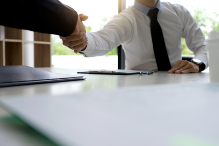 Successful businessmen handshaking after good deal. Business handshake and business people.  boss hand shake to a new work who just pass job interview to be a new staff 写真素材
