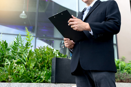 business man chairman stand in front of office building