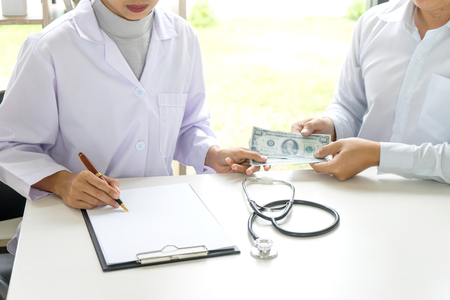 Business man or patient give bribe to the doctor concept corruption