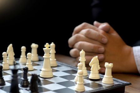 Businessman thinking how to play chess concept business strategy for win Stock Photo