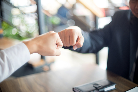 two business man use hand to fist bump for succes teamwork coporate  Banque d'images