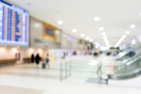 Blur airport hall big termial interior area for arrival travel passenger