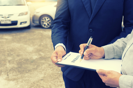 On the road car accident insurance agent examining carcrash  owner and insurance staff make paper form
